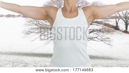 Digital composite of Fitness woman making fitness exercises with a countryside background