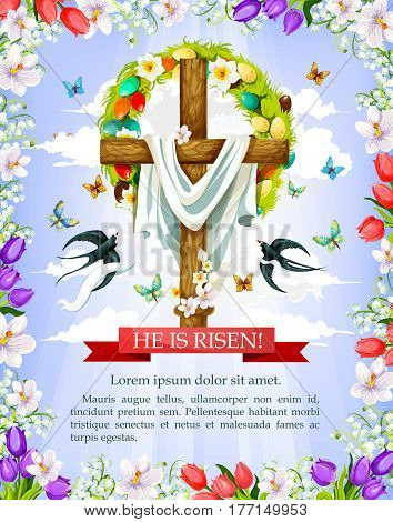 Easter cross greeting card wit floral frame. Crucifix with Easter wreath of egg and spring flower, flying butterfly and swallow bird with He Is Risen ribbon banner on blue sky background
