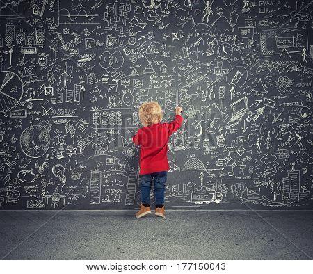 Children draws diagrams and statistics on a blackboard