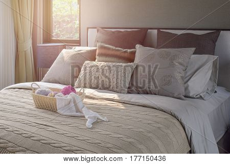 Knitting Basket On Warm Classic Style Bedding With Many Texture Of Pillows-sunlight Effect
