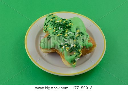 Shamrock-shaped Holiday donut with green frosting for Saint Patrick's Day