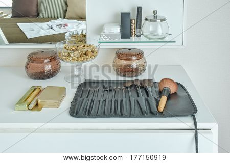 Brushes Setting On White Top Dressing Table