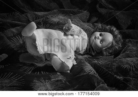 An old , despair useless doll .