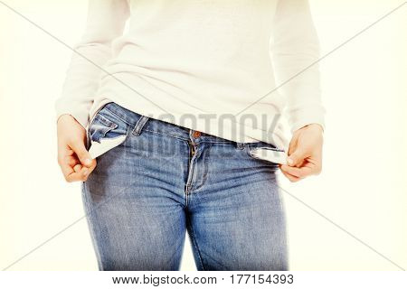 Young woman with empty pockets