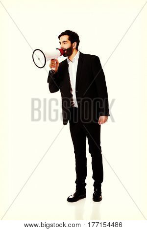 Businessman shouting using a megaphone.