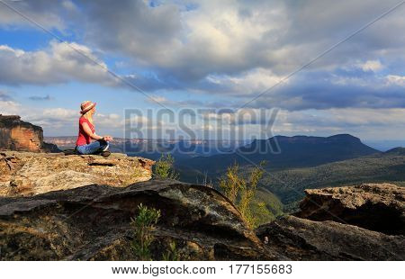 Woman Peaceful Yoga On Mountain Summit