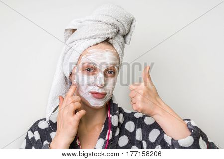 Woman Applying Natural Facial Mask From Sour Cream