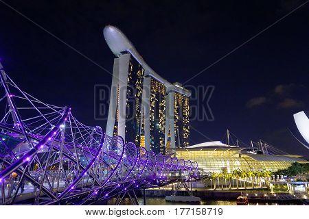 Singapore, Singapore - February 11, 2017: Singapore river and Marina Bay Sands skyscraper view.