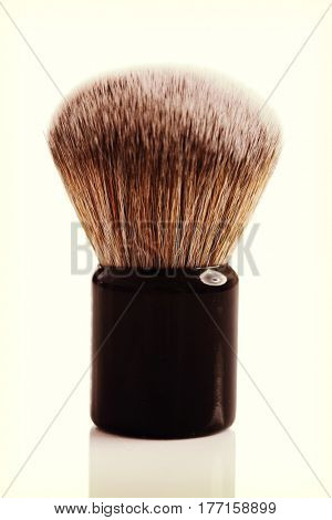 small foundation makeup brush isolated on white