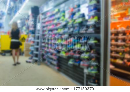 Abstract Blurred photo of sneaker shop .