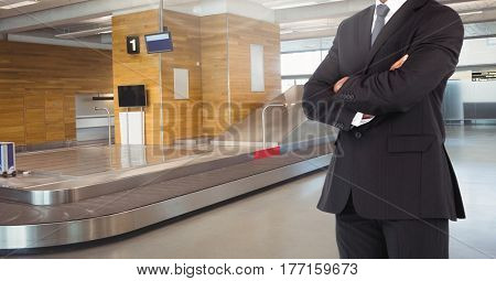 Digital composite of Businessman Torso against a airport background