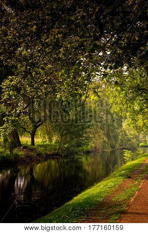 A springtime view of a park and a canal at Bussum the Netherlands. The cozy little town is full of pittoresque details like this.