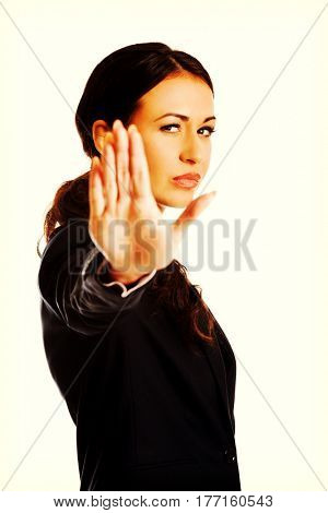 Businesswoman making stop sign