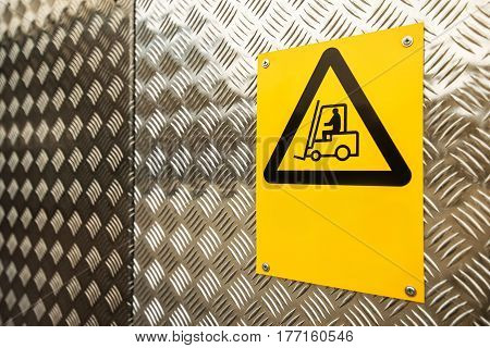 Fork lift truck warning sign on construction site