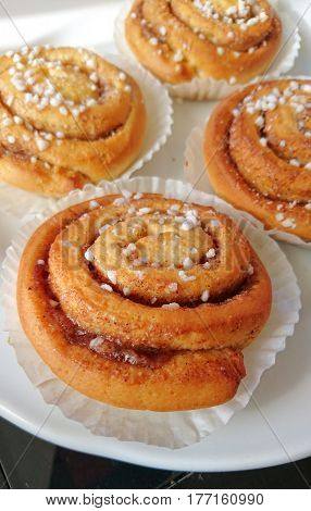 Sweet swedish rolls with cinnamon also known as bulle