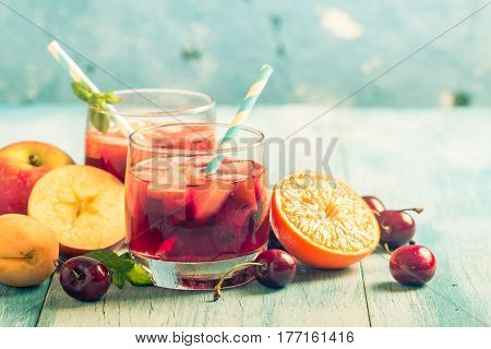 Refreshing sangria or punch with fruits in glasses