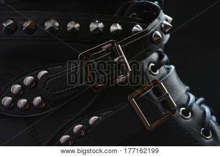 item of footwear in the Gothic style with straps and studs