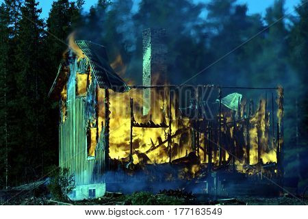 Burning home. House completely engulfed in flames.