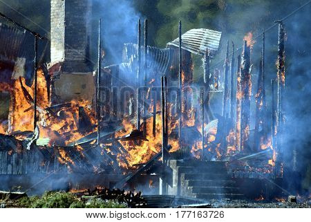 Wooden house destroyed by fire. horizontal image.