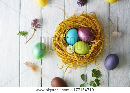 nest with painted eggs, Easter background. Top view