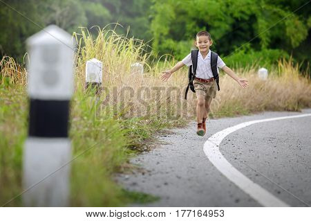 happy little boy go home from school