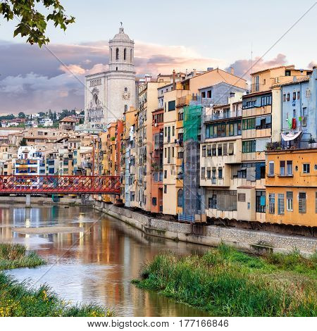 historical jewish quarter in Girona with Eiffel Bridge at sunrise, Barcelona, Spain, Catalonia