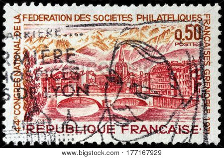 LUGA RUSSIA - FEBRUARY 7 2017: A stamp printed by FRANCE shows view of Grenoble - city in southeastern France at the foot of the French Alps circa 1971.