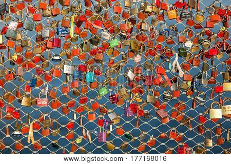 SALZBURG, AUSTRIA - APRIL 29, 2016: Close up of padlocks as a symbol of everlasting love at a bridge in Salzburg (Austria) over the river Salzach