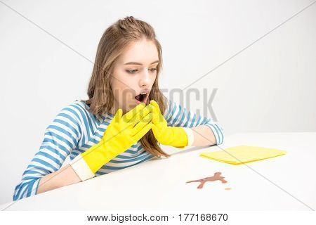 Shocked Woman Looking At Stain