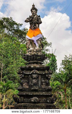 God Statue In Tirta Empul Temple, Bali, Indonesia