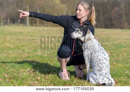 Pretty Young Woman Teaching Her Dog Commands