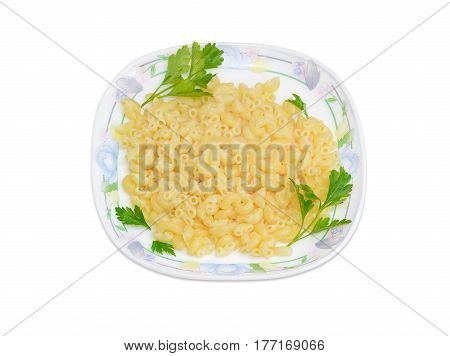 Cooked short curved macaroni decorated with a small parsley twigs on a dish on a light background