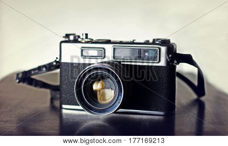 Photography Vintage Slr camera on a wooden surface Karachi Pakistan. 30-03-2017