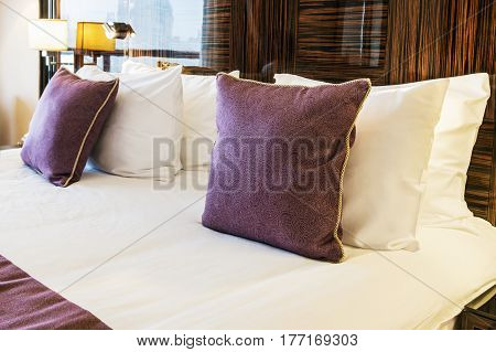 set of pillows on the bed of king size in the hotel
