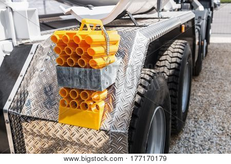 Rear bumper of construction machine with accessories. Concrete Batching Machine