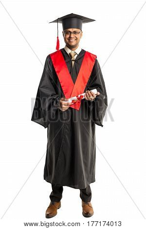 Male african american graduate in gown and cap isolated over white background