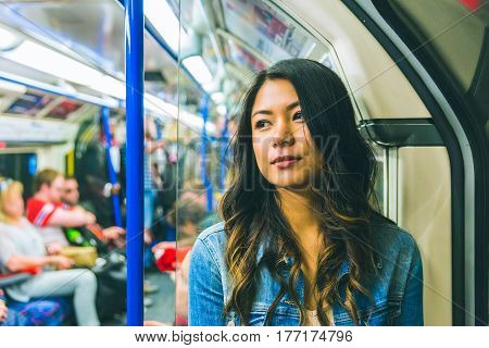Asian Woman On The Tube In London
