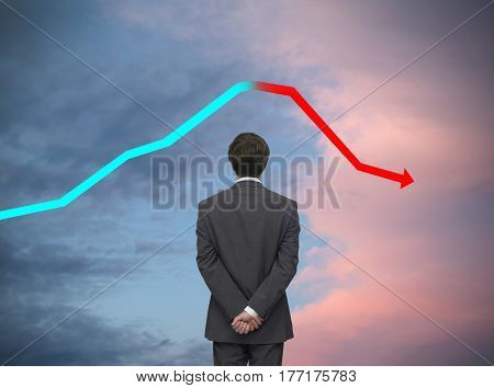 businessman in a suit watching a performance chart