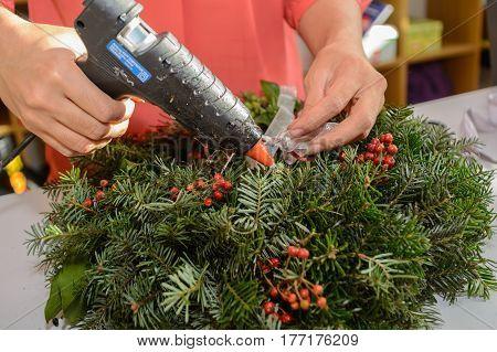 Florist created advent wreath by hot glue gun