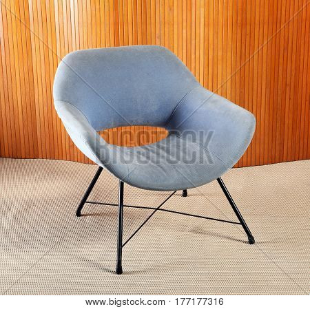 Retro Blue Velvet Chair With Black Legs In Room