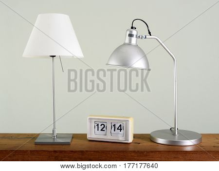 Two Table Lamps On Desk With Retro Flip Clock