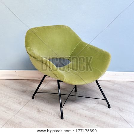 Retro Green Velvet Chair In Room With Blue Walls