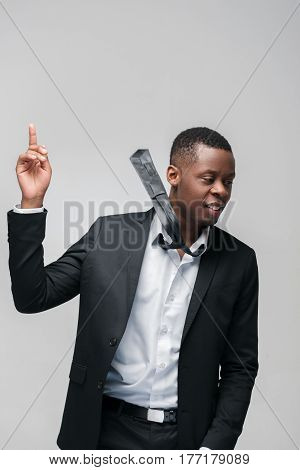 African american guy solved problem. Getting new idea, great decision, finding right way. Grey background with free space.