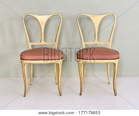 Pair Of Yellow Retro Chairs With Pink Padded Seats