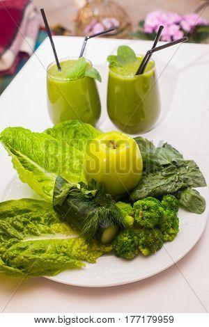 Healthy green smoothie and ingredients - superfoods detox diet health vegetarian food concept