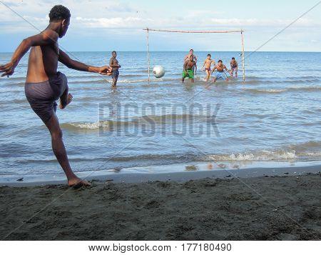 Boys Playing Football On The Coast Of Livingston