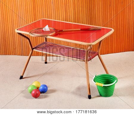 Small Retro Games Table With Racket And Toys