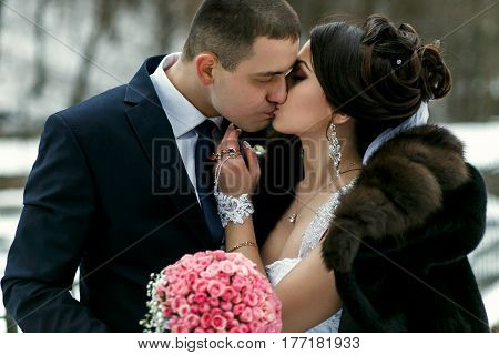 The Lovely Couple In Love Kissing In The Park