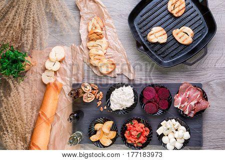 Bruschetta Ingredients For Preparation Near Grill Pan. Italian Cuisine Food Antipasto, Crostini. Top