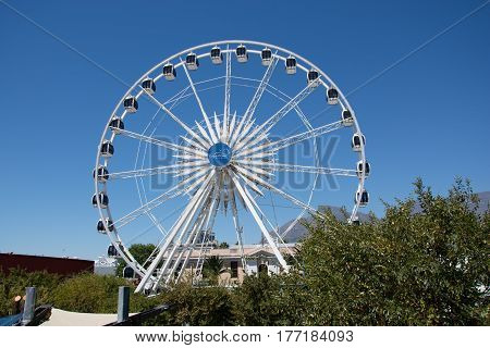 Cape Town South Africa - March 02 2017: The Cape Wheel at the V&A Waterfront with blue sky